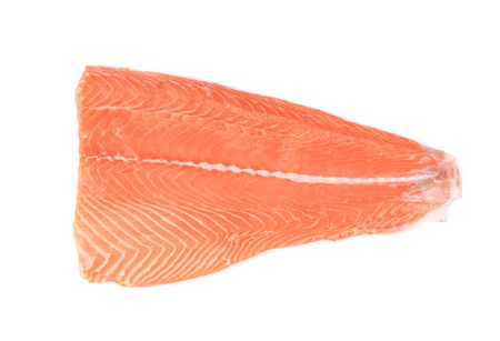 Fresh uncooked red fish fillet. Isolated on a white background. photo