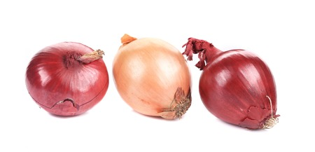 aftertaste: Three beautiful onion bulbs. Isolated on a white background.