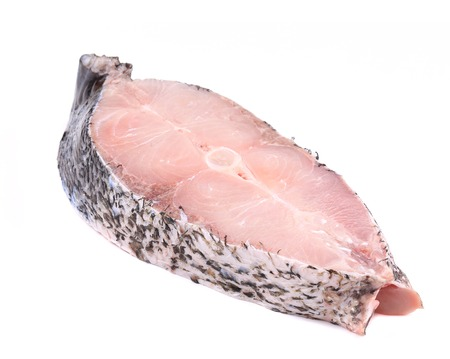 Fresh carp steak. Isolated on a white background. photo