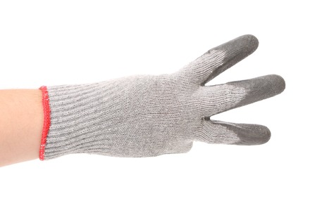 Hand in gloves shows three. Isolated on a white background.