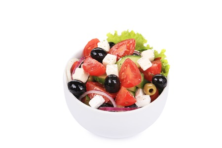 Greek salad in bowl. Isolated on a white background. photo