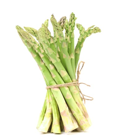 nutritiously: Fresh asparagus. Isolated on a white background.