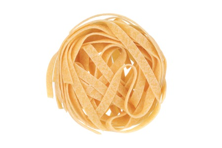 A portion of tagliatelle. Isolated on a white background. photo