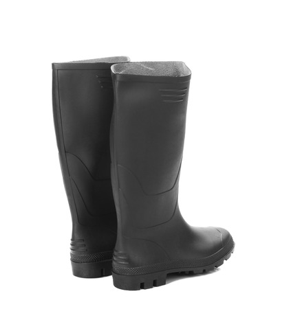 Black rubber overshoe. Isolated on a white background. photo