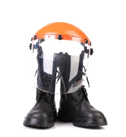Hard hat and working boots. On a white background. photo