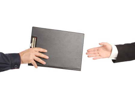 Hand giving a folder. On a white background. photo