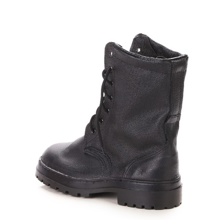 Black leather boot. Isolated on a white background. photo