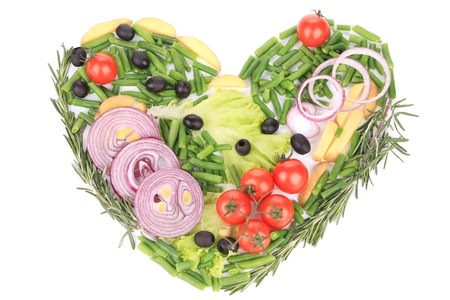 Heart shape made with various vegetables. Isolated on a white background. photo