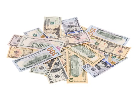 Heap of dollars. Isolated on a white background. photo
