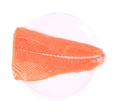 Raw salmon fillet. Isolated on a white background. photo