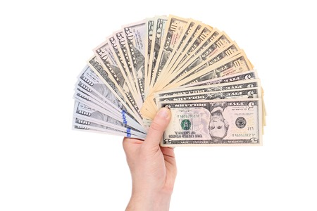 Pile of dollars banknotes in hand. Isolated on a white background. photo