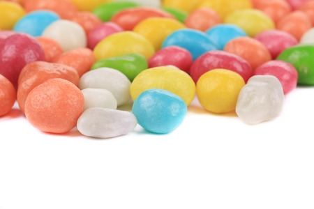 Chocolate balls in colorful glaze. Isolated on a white background. photo