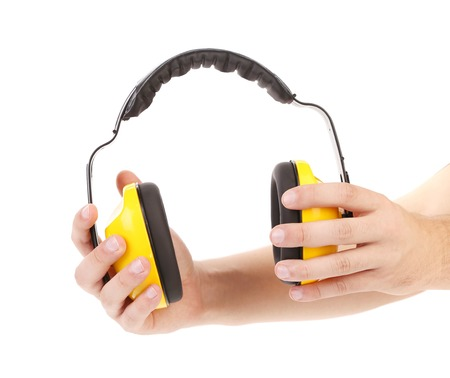 Ear protectors in human hand. On a white background. photo
