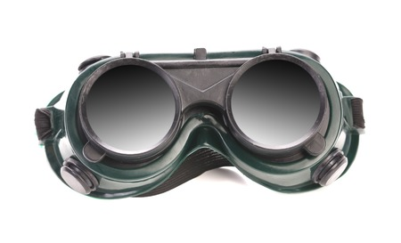 Green welding glasses. Isolated on a white background. photo