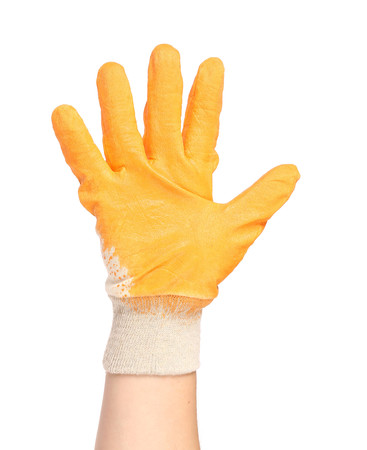 Hand in rubber glove shows four. Isolated on a white background. Stock Photo