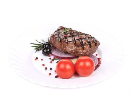 Big juicy grilled steak with greens. Isolated on a white background. photo