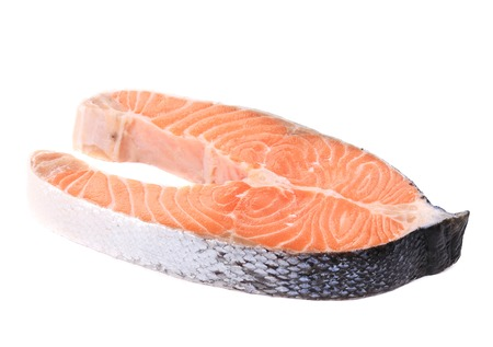 Fresh salmon steak. Isolated on a white background. photo