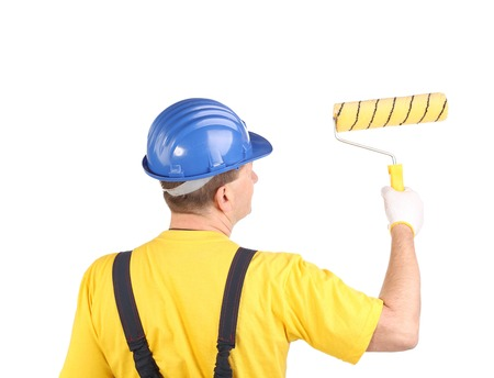 Worker with roller. Isolated on a white background. photo