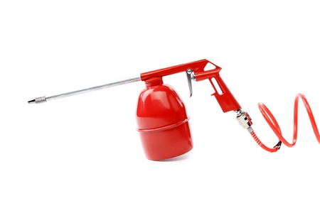 dampen: Spray gun with plastic spring. Isolated on a white background. Stock Photo