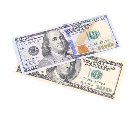 ben franklin money: American dollar bills. Isolated on a white background.