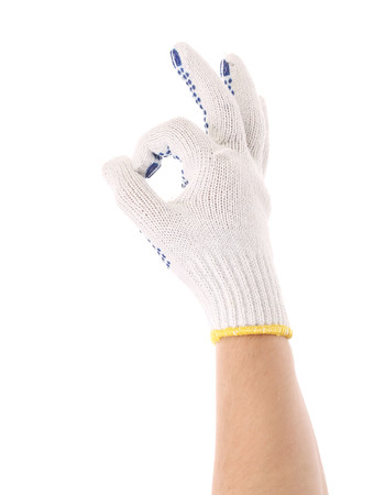 Hand in work glove shows ok sign. Isolated on a white background. photo