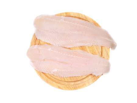 pangasius: Pangasius fillets on platter. Isolated on a white background. Stock Photo