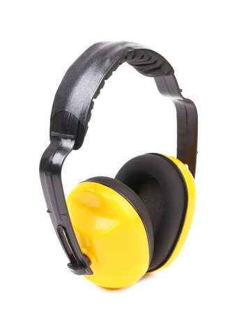 Yellow protection headphones. Isolated on a white background. photo