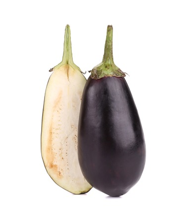 One halved eggplant. Isolated on a white background. photo