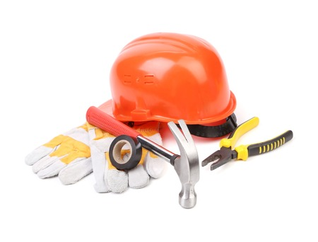 Hard hat, hammer, pliers and work gloves. Isolated on a white background. photo