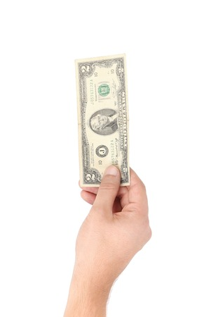 two dollar bill: Hand holding two dollar bill. Isolated on a white . Stock Photo