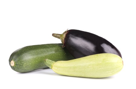 Close up of zucchini and eggplant. Isolated on a white . photo