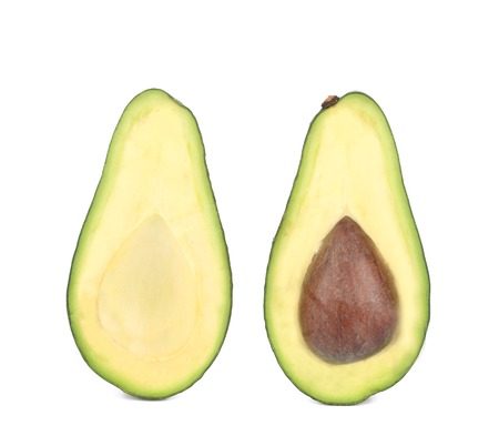 Sliced ripe avocado. Isolated on a white . photo