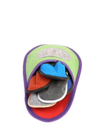 houseshoe: Colorful slippers into big slipper. Isolated on a white . Stock Photo
