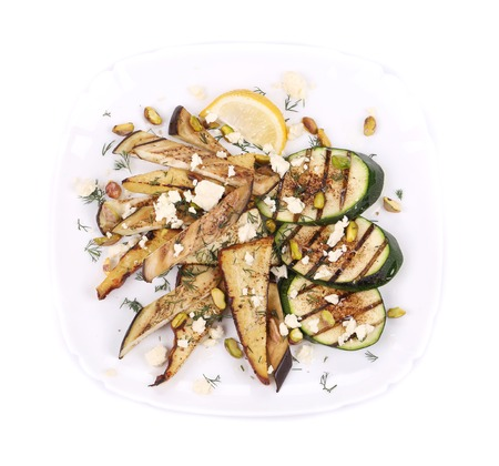Salad with grilled vegetables and tofu. Isolated on a white . photo