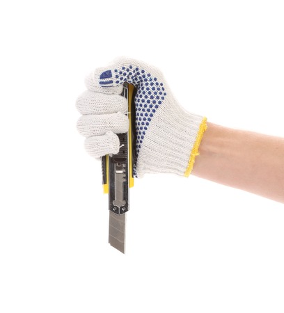 boxcutter: Hand holds yellow stationery knife. Isolated on a white background.