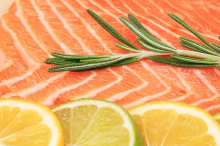 Closeup of salmon steak with rosemary. photo