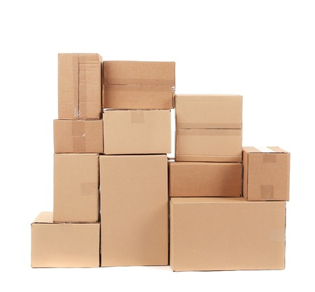 Stack of cardboard boxes. Isolated on a white background. photo