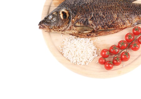 Grilled fish with rice and tomatoes. Isolated on a white . photo