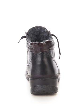 Back side of leather boot. Isolated on a white background. photo