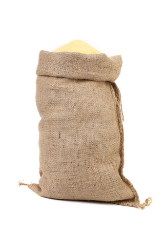 Canvas bag with cornmeal. Isolated on a white background. photo