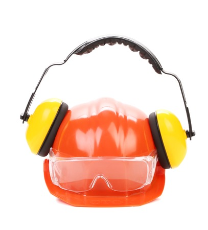 Orange safety helmet and protection headphones.  Isolated on a white . photo