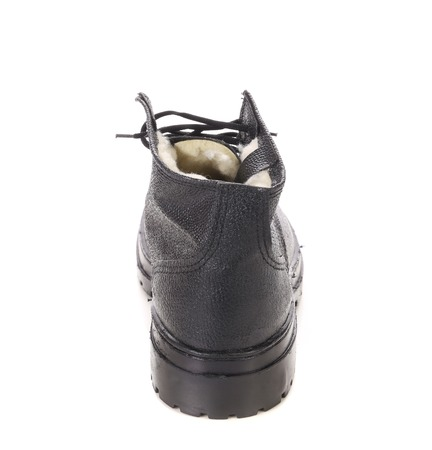 Back side of black boot. Isolated on a white . photo