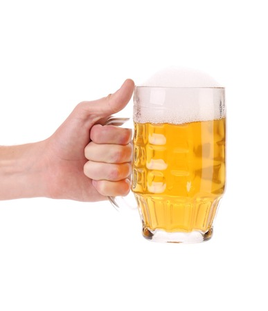 wallop: Male hand holding up a glass of beer. Isolated on a white background.