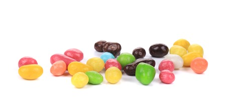 Heap of sweet colorful glaze candies. Isolated on a white background. photo
