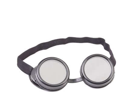 Closeup of welding glasses. Isolated on a white background. photo