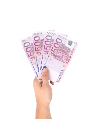 Man hands holding five hundred euro banknotes. Isolated on a white background. photo