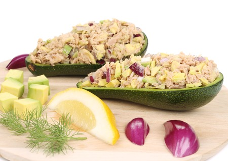 Avocado salad and tuna. Isolated on a white background. Foto de archivo