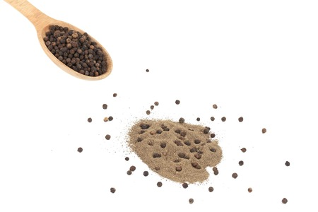 Powdered black pepper and peas. Isolated on a white background. photo