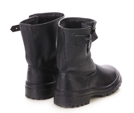 Black leather boots. Isolated on a white . photo
