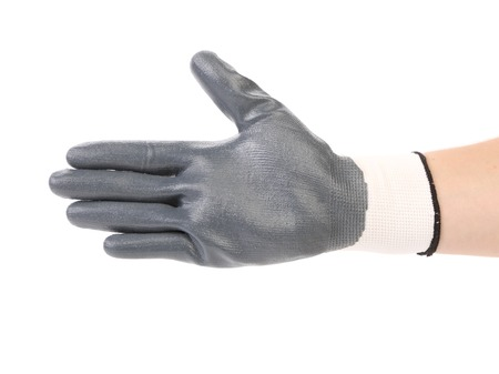 Hand in black rubber glove. Isolated on a white background. photo